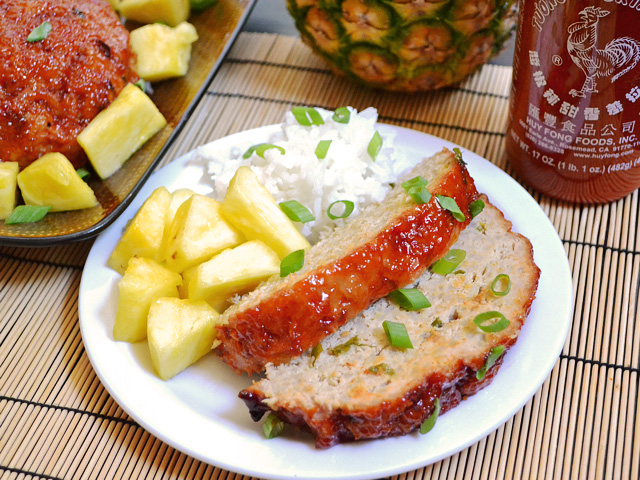 Plate of two slices of Thai Turkey Meatloaf with a side of rice and side of pineapple