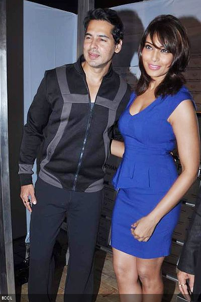 Dino Morea and Bipasha Basu pose for the cameras during the opening of Dino's fitness brand, in Mumbai. (Pic: Viral Bhayani)