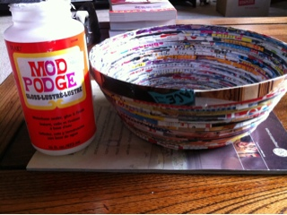 One of my favorite ways to recycle magazines is to make magazine bowls. These are easy to make with few additional resources, sturdy, and eye-catching. They make great gifts and gift baskets, or can be used as decorative catchalls around the house.