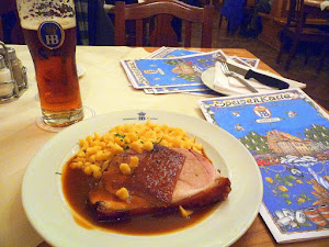 Roast pork from Bavarian production with crackling in natural gravy with Spaetzle egg noodles at Hofbrauhaus (enjoyed with a Dark Radler, which is their Dark Beer with lemonade