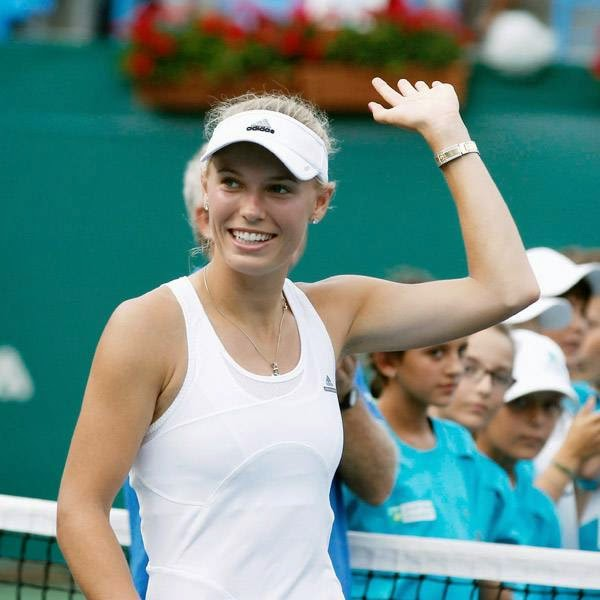 Caroline Wozniacki of Denmark celebrates after her victory against Roberta Vinci of Italy in their Istanbul Cup women's singles final tennis match, in Istanbul July 20, 2014.