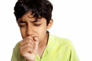 Indian Boy/Teenager coughing sneezing and down with Flu