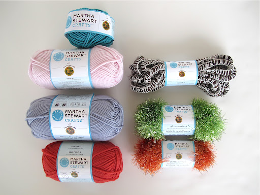 The yarn assortment in the giveaway includes Mambo and Glitter Eyelash!