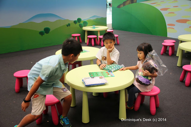 The kids at the activity corner beside the Clubhouse Playground