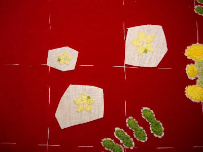 Ruth O'Leary Textile Art - rough cut-outs of embroidered flowers to be applied