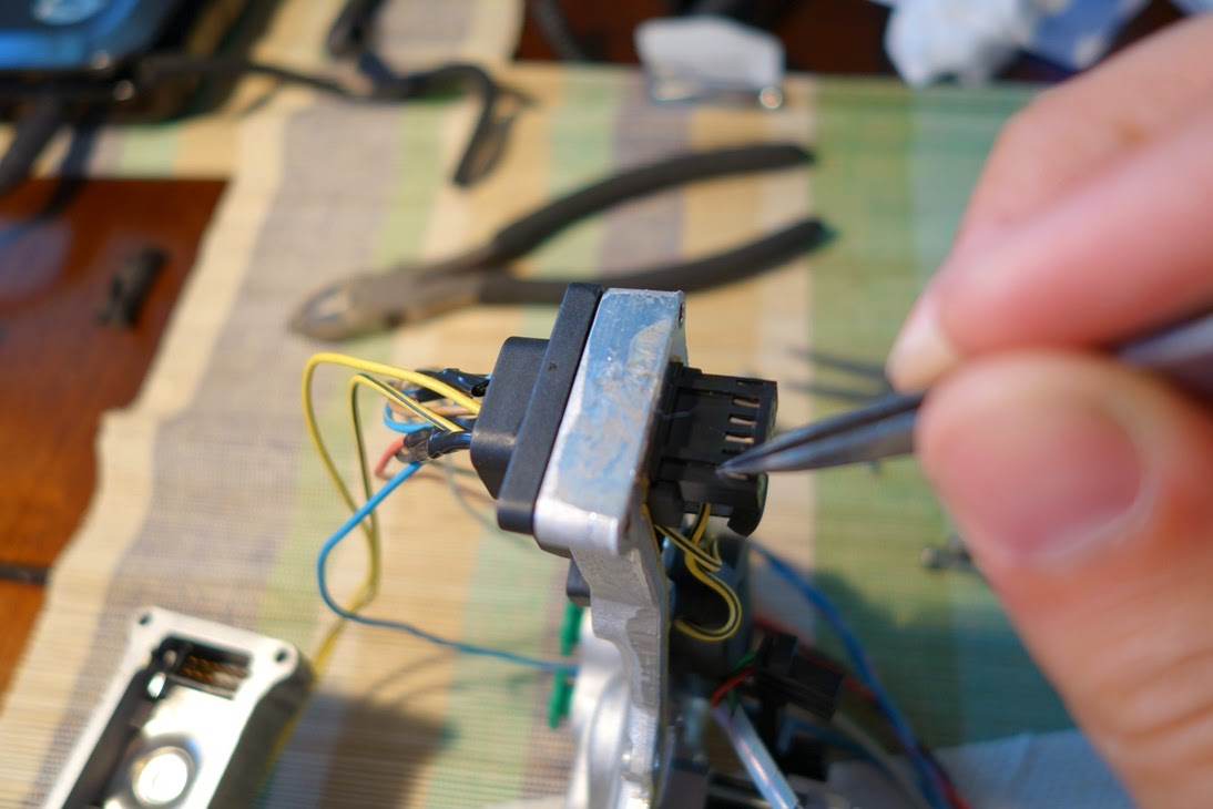 STEP 5: Trace the wires and release the terminal ends from the terminal  housing, and then pull the wires out. I used pointed tweezers. You can use  a pick.