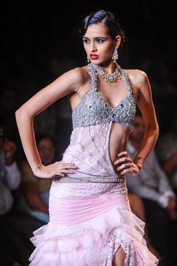 A model showcases a creation for Gitanjali on Day 2 of India International Jewellery Week (IIJW), 2014, held at Grand Hyatt, in Mumbai.<br />