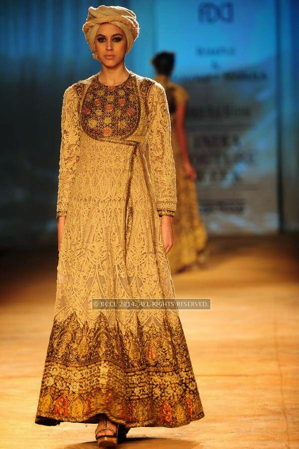 A model walks the ramp for Rimple and Harpreet on Day 6 of India Couture Week, 2014, held at Taj Palace hotel, New Delhi.