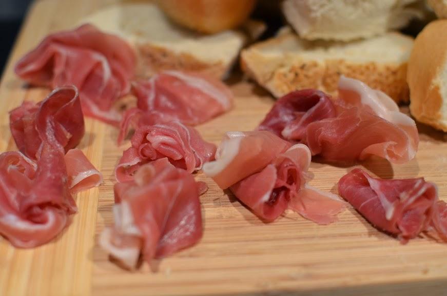 prosciutto on bread board