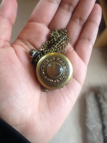 A pendant pocket watch with beaded case