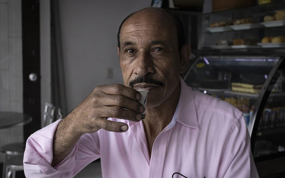colombian man drinking coffee