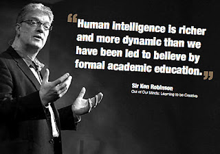 Sir Ken Robinson speaking and pointing his finger