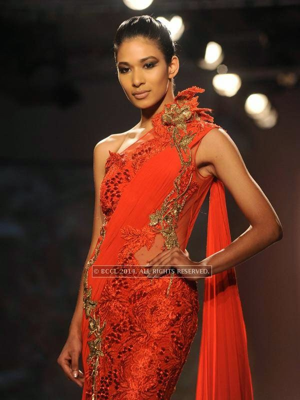 A model showcases a creation by designer Gaurab Gupta on Day 3 of India Couture Week, 2014, held at Taj Palace hotel, New Delhi.