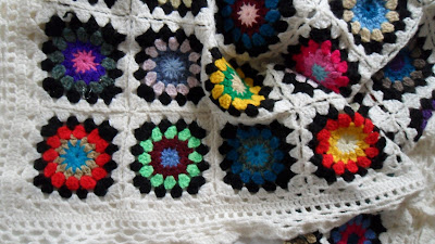 Crochet granny square blanket, another corner of the blanket showing different coloured squares