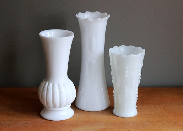 Wide mouth milk glass vases available for rent from www.momentarilyyours.com, $1.50 each.