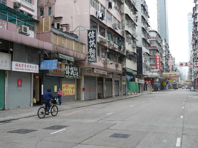 a mostly empty Reclamation Street in Hong Kong with many closed stores