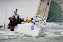 J/109 one-design racer cruiser sailboat- sailing with spinnaker on Solent, England