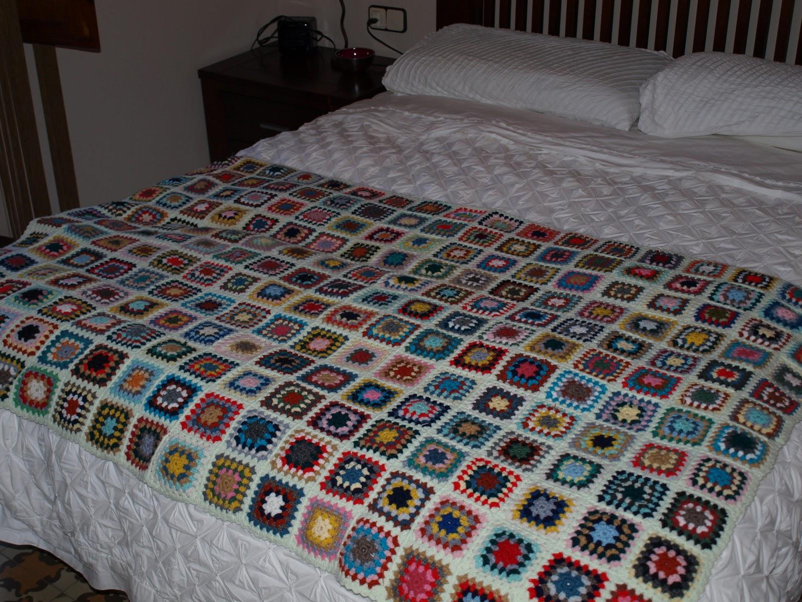 Hilo y punto manta de sof for Sofas y punto
