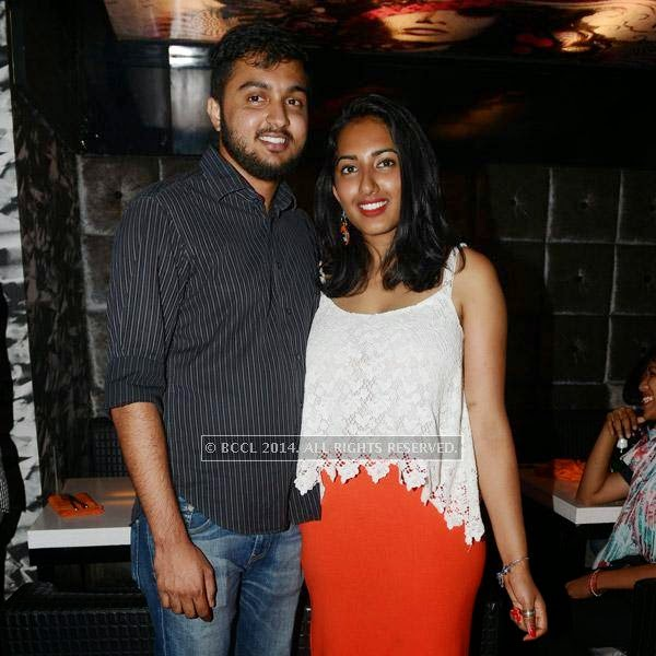Ashwin and Rhea pose together during a get-together party at Pub Illusions.