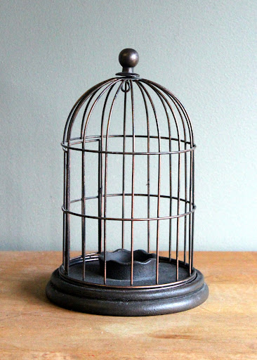 Bronze birdcage available for rent from www.momentarilyyours.com, $1.00.