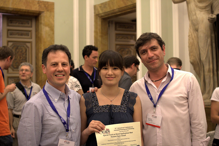 Chiara receives her award at the ICAPS 2013 banquet
