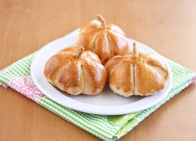 photo of three pumpkin rolls on a plate