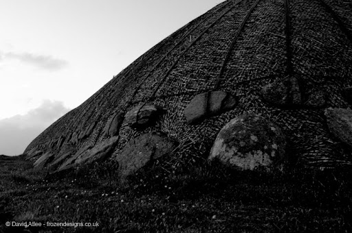 A traditional Isle of Lewis  blackhousemade of rocks and tatched roof