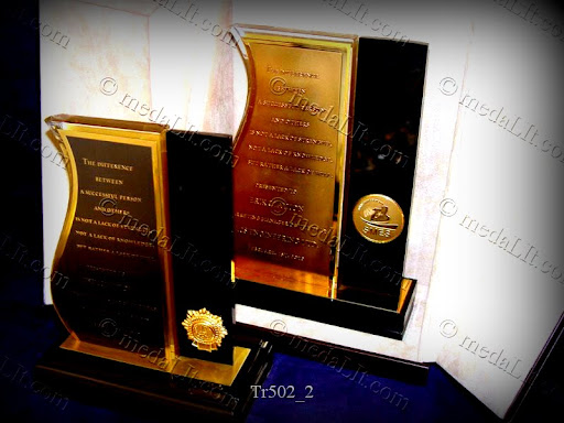 Luxury Trophy. Combination of engraved plated or patinated engraved plates, medals and acrylics.