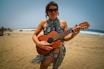 Jenny works on new song whilst trying to hide those cyclist tan lines. Playa Ventura, Guerrero