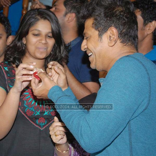 Shivarajkumar and his daughter during the former's birthday celebrations, in Bangalore.