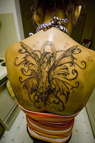angel tattoos on back of women