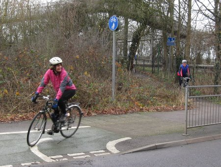Cyclist descends from cycle bridge