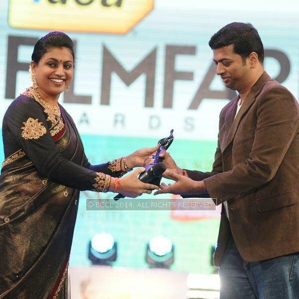 Roja presents the award to Sriram Parthasarathy in Tamil for the song 'Anandha Yazhai' from the film 'Thanga Meengal' during the 61st Idea Filmfare Awards South, held at Jawaharlal Nehru Stadium in Chennai, on July 12, 2014.