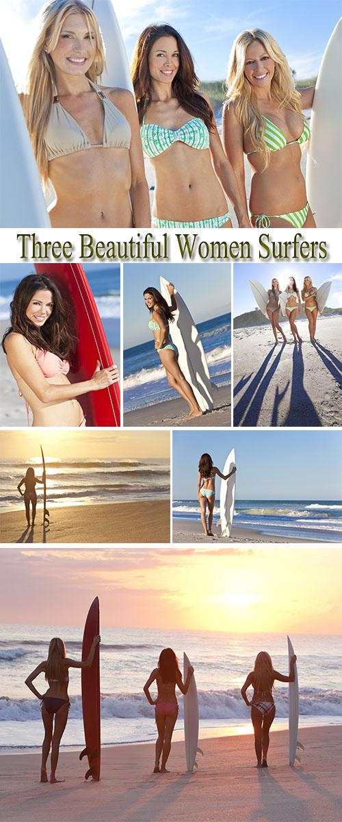 Stock Photo: Three Beautiful Women Surfers