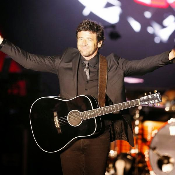 French singer Patrick Bruel performs on stage during the Monte Carlo Summer Festival on July 22, 2014 in Monaco.