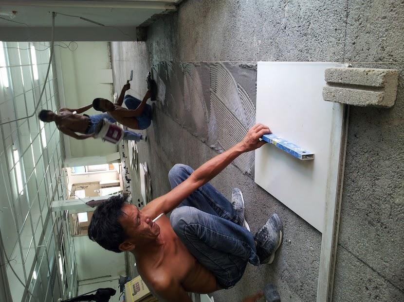 laying new floor tiles