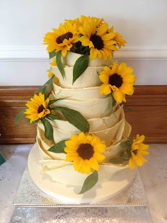 White Chocolate Wedding Cake decorated with Sunflowers - The Yummy Cake Company