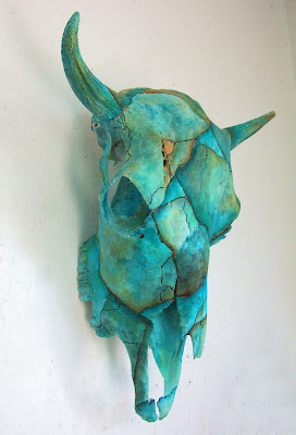 side view of Cow skull painted turquoise