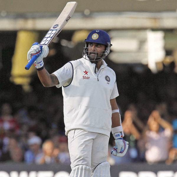 India's Murali Vijay acknowledges the crowd after reaching 50 runs not out during play on the third day of the second cricket Test match between England and India at Lord's cricket ground in London on July 19, 2014.