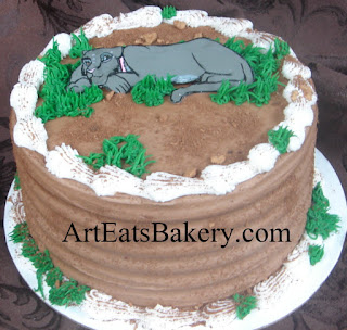Panther custom creative chocolate birthday cake with edible grass and dirt