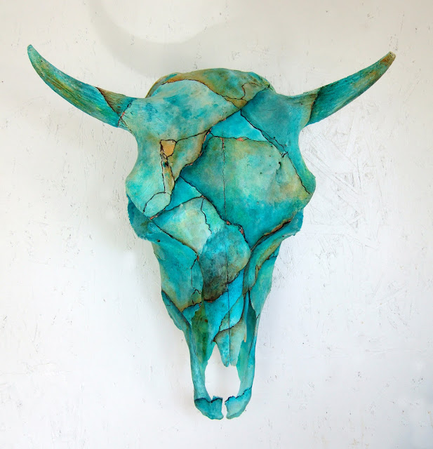 Cow skull painted turquoise
