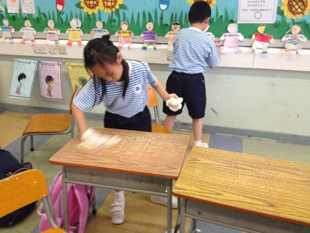 children cleaning classroom