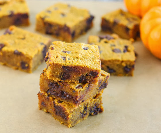 photo of a stack of Pumpkin Chocolate Chip Bars with more in the background