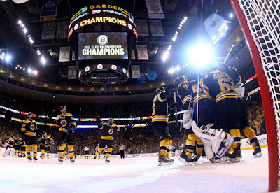 Bruins players celebrate winning the Eastern Conference Finals