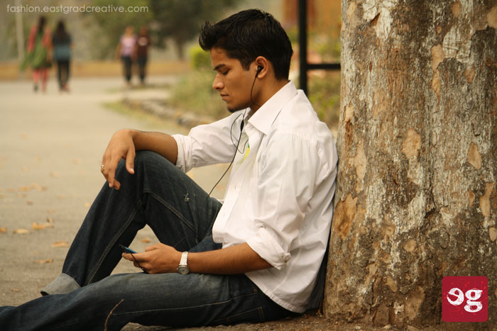 Casual white shirt folded till the elbow with a folded jeans for a casual day.