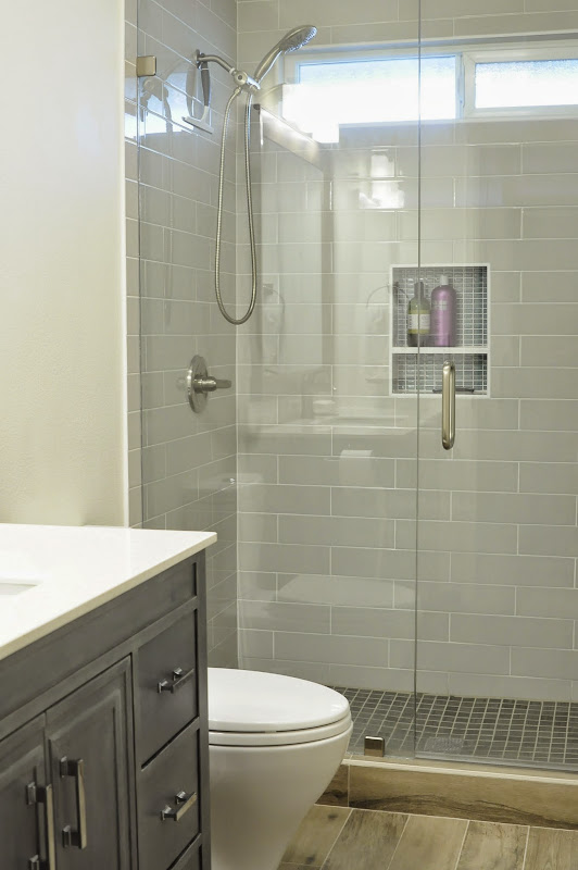 Small bathroom with gray tiles