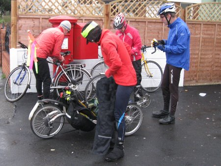 Cyclists donning waterproofs