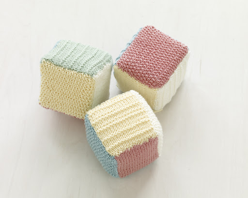 Loom knit baby blocks.