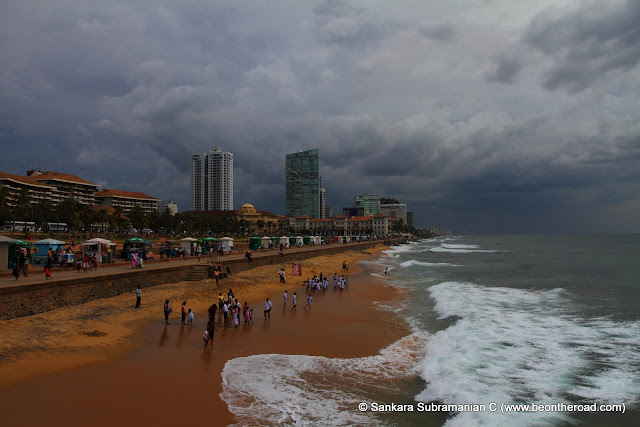 Locals and Tourists throng to Colombo's Marine Drive on a cloudy afternoon