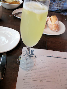 Ox restaurant cocktail Life After Paris with Prosecco, Pineapple, Anise Sorbet, and Kubler Absinthe